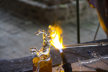 Glass rod melted and bended to be horse model