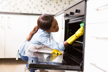 african woman cleaning in the kitchen