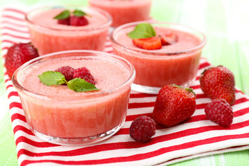 Delicious berry mousse in bowls on table close-up