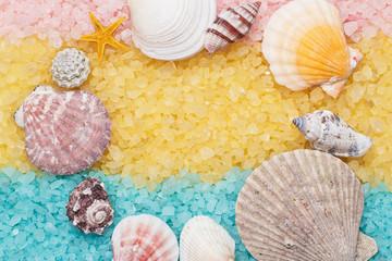 blue and yellow bath salt and seashells background