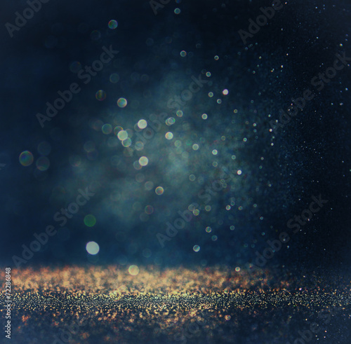 glitter vintage lights background. gold, silver, blue and black.