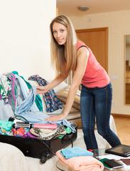 Girl packing luggage