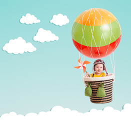 cute kid on hot air balloon in the blue sky