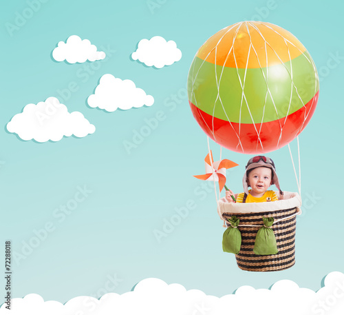 canvas print picture cute kid on hot air balloon in the blue sky