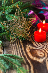Christmas decoration. Christmas candles and pine branch