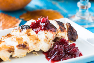 Sliced chicken breast with cranberry sauce