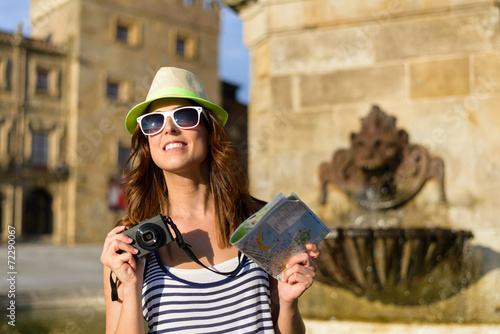 canvas print picture Female tourist with camera and guide map sightseeing