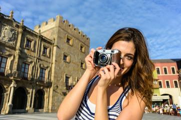 Female tourist taking photo in Gijon Spain