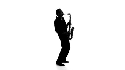 Silhouette of a musician who plays the saxophone on a white