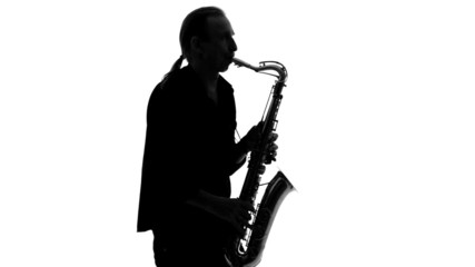 Silhouette of musician enthusiastically playing the saxophone on