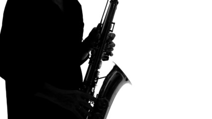 Close up of silhouette of musician playing the saxophone