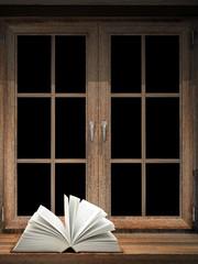 Open book on windowsill