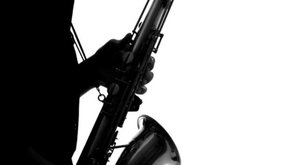 Close up of silhouette of talented musician playing the