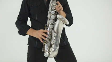 Professional saxophonist performs tunes on his saxophone