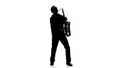 Silhouette of a man playing the saxophone on a white background
