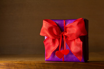 Purple gift red bow hearts