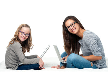 Young students with laptops.