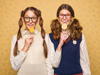 Young female nerds with lollypop
