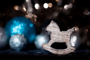 Christmas decoration rocking horse with bokeh background