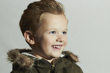 Smiling child.happy little boy winter style.Emotion