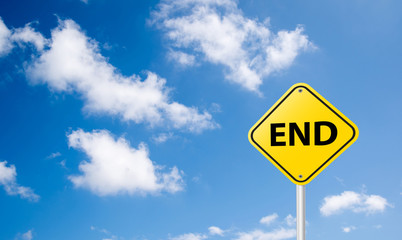 end sign on blue sky background