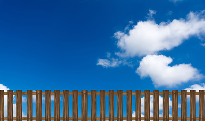 wooden fence on a blue sky background