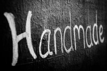 Handmade word written on blackboard, shallow depth of focus
