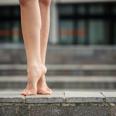 Close up of young ballerina bare feet. Ballerina Project.