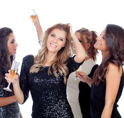 Elegant women celebrating christmas dancing in the party