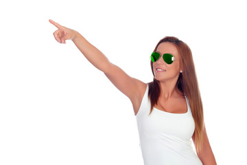 Funny girl with sunglasses indicating at side