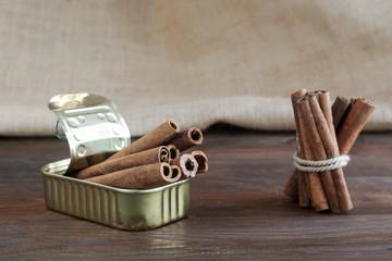 Tin can with cinnamon sticks