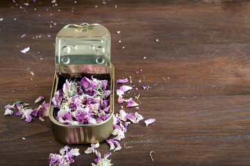 Tin can with pink flowers