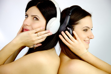 Two happy girlfriends listening music together