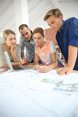 Group of young people studying architecture