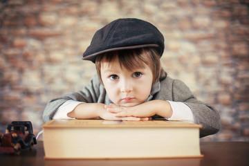 Close portrait of boy with big book