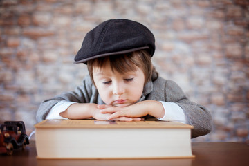 Close portrait of boy with big book