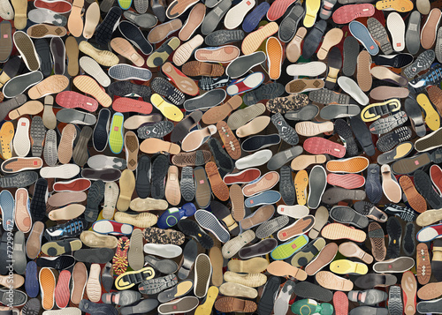 canvas print picture Background. A big bunch of different shoes, the soles.