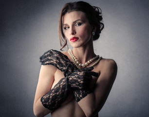 Sensual woman wearing gloves