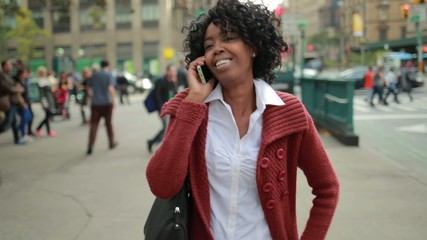 African American black woman in city talking cellphone