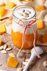 Festive dessert of pumpkin, yogurt and seeds