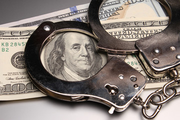 Handcuffs on money, criminal