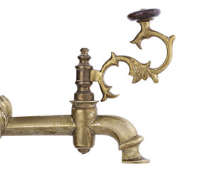 Antique tap over white isolated background