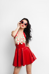 Sexy woman in red latex dress with sunglasses