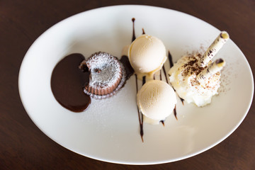 chocolate lava cake set with ice cream on white plate