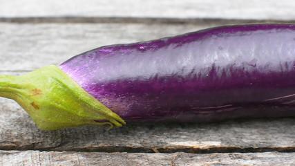 camera dolly, eggplant on wood background