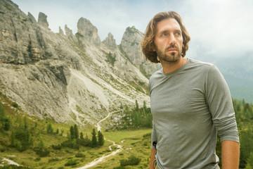 Hiker man - Portrait - behind huge mountains of the Dolomites