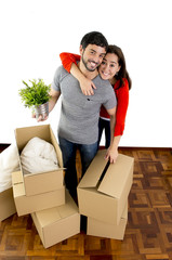 couple moving together in new house unpacking cardboard boxes