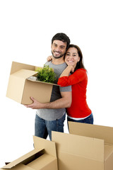 happy couple moving in new house unpacking cardboard boxes