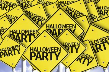 Halloween Party written on multiple road sign