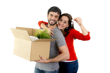 happy couple moving together new house unpacking cardboard boxes